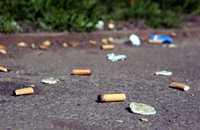 a photo of cigarette butts on the floor