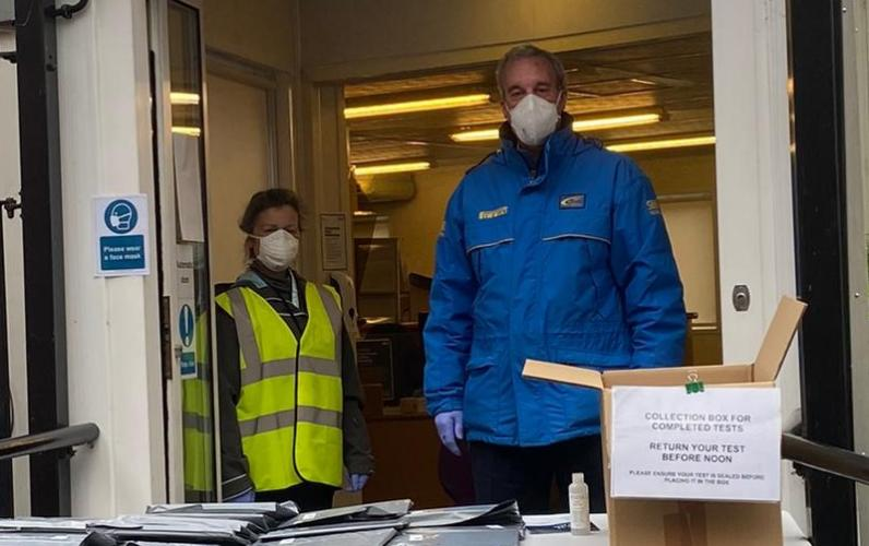 Chairman Cllr Robin Dray assisting volunteers at South Street offices