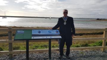 Cllr Dray unveiling the interpretation board at the Wallasea observation platform
